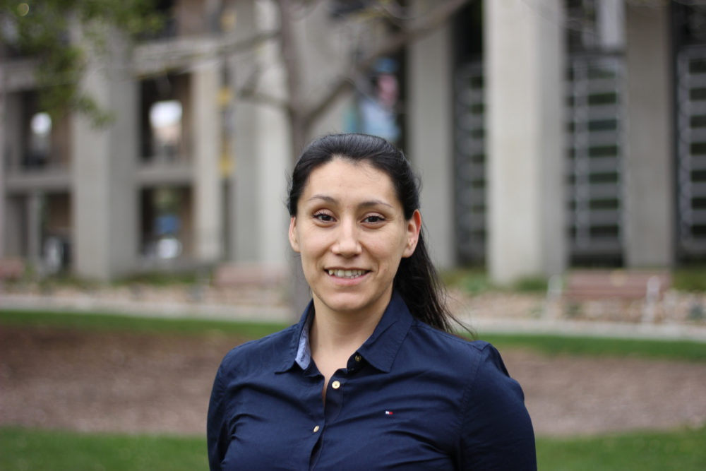 Maria Andrade smiles in photo on UCSD campus.