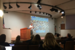 Man at podium speaks at Berkeley Learning Analytics Conference