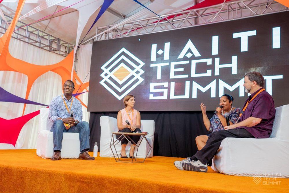 Michael Dennin (right) and fellow panelists speaking at the 2018 Haiti Tech Summit.