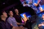 From left, Eric Lo, structural engineering Ph.D. student Michael Hess and Falko Kuester in the WAVE lab navigating the Turin virtual reality. Photo by Erik Jepsen/UC San Diego Publications