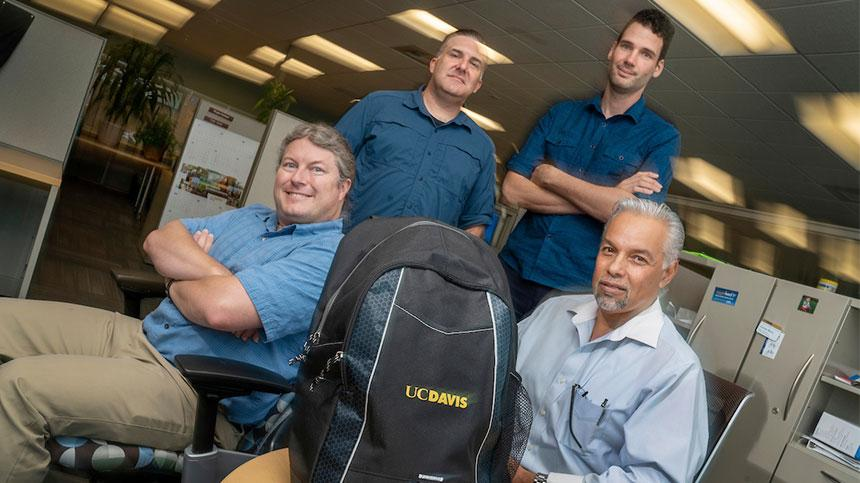 Among those who worked on the technology for Article 26 Backpack are, from left to right, Shawn DeArmond, web architect; web developers Carson Black and Jeroen Post; and project manager Erie Comer.