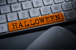 "keyboard with an orange ""Halloween"" button replacing the spacebar"