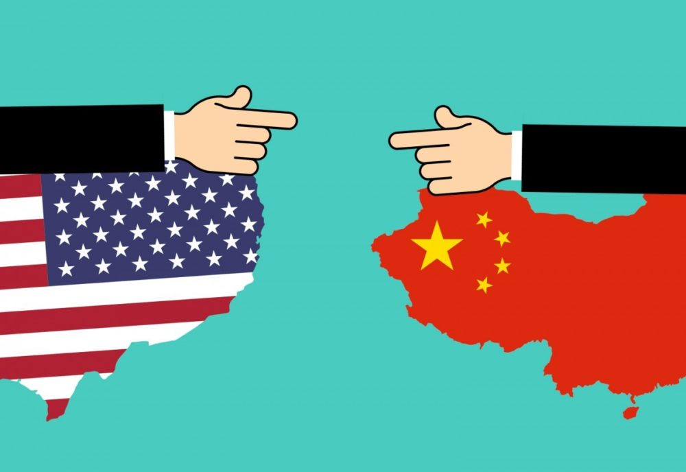 Illustration of the United States and Russia pointing fingers at one another