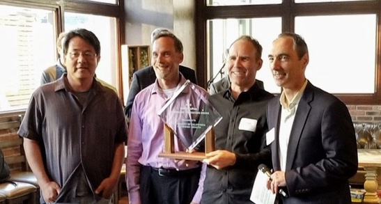 Tom Andriola, UC CIO, poses with a team from UCSD while presenting them with their UC IT Innovation Award - presented by Cisco & ePlus.
