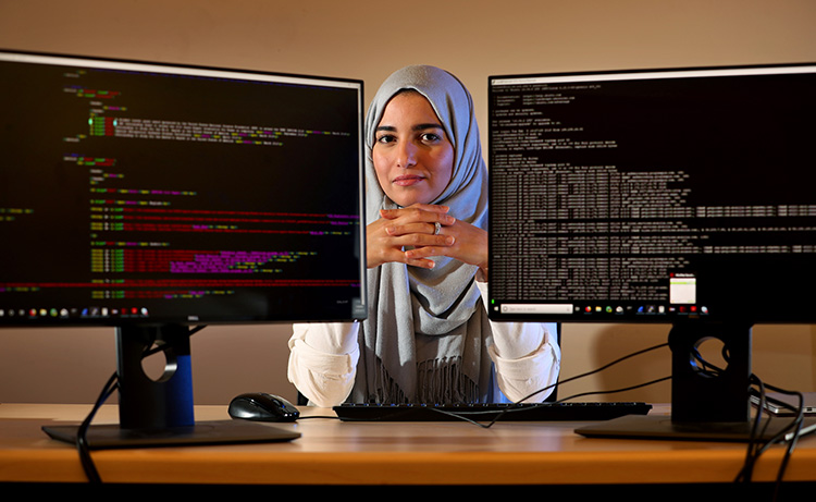 Portrait of PhD candidate Fatemah Alharbi, with UCR's Computer Science and Engineering Department, on March 20, 2019. Alharbi recently made headlines after Apple Inc. acknowledged her for helping discover a flaw in their security system. (UCR/Stan Lim)