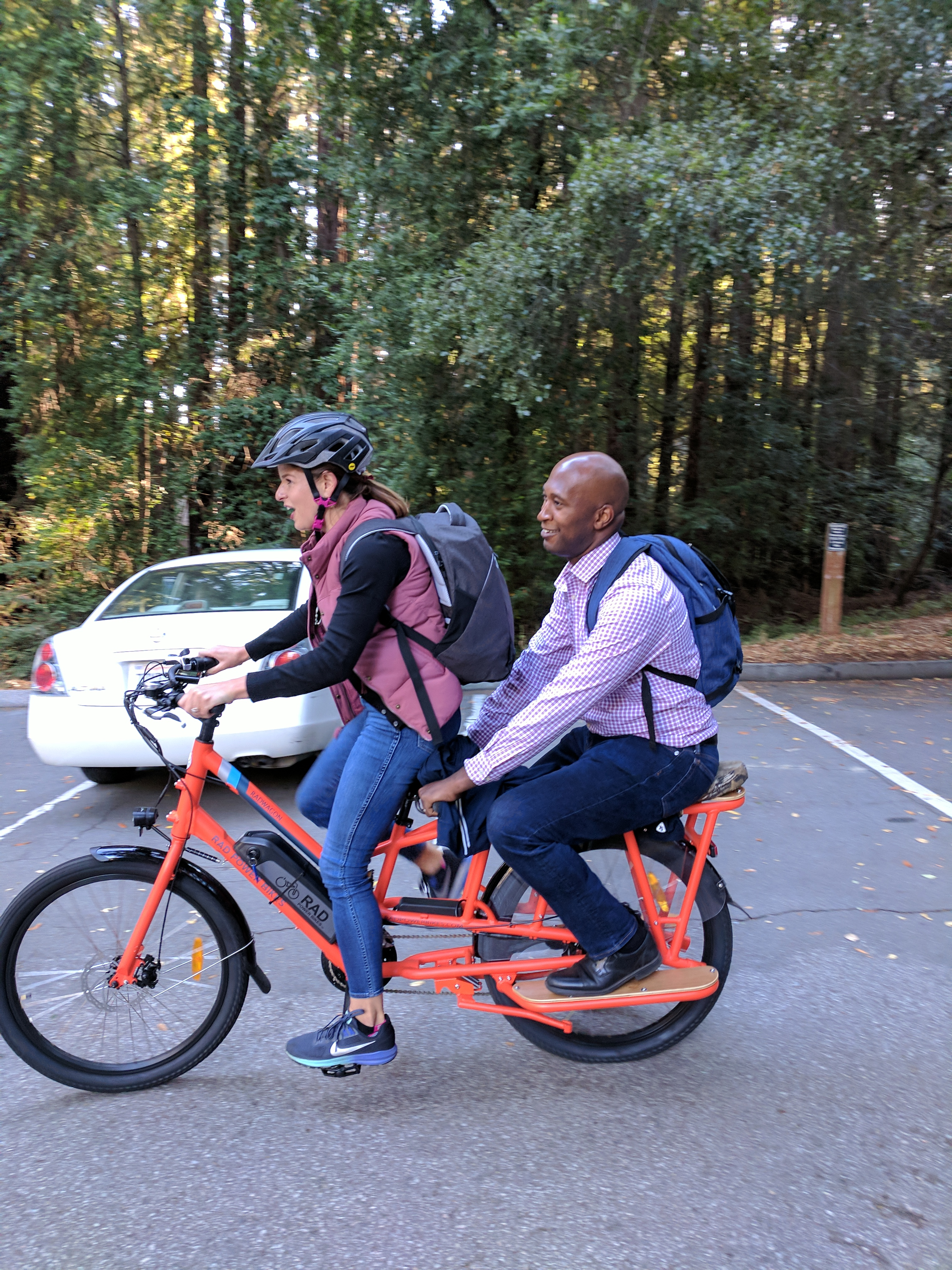 Van Williams and Melanie Douglas, UCSC director of Client Services and Support and Interim Chief Technology Officer, ride a two-person bike to a meeting.