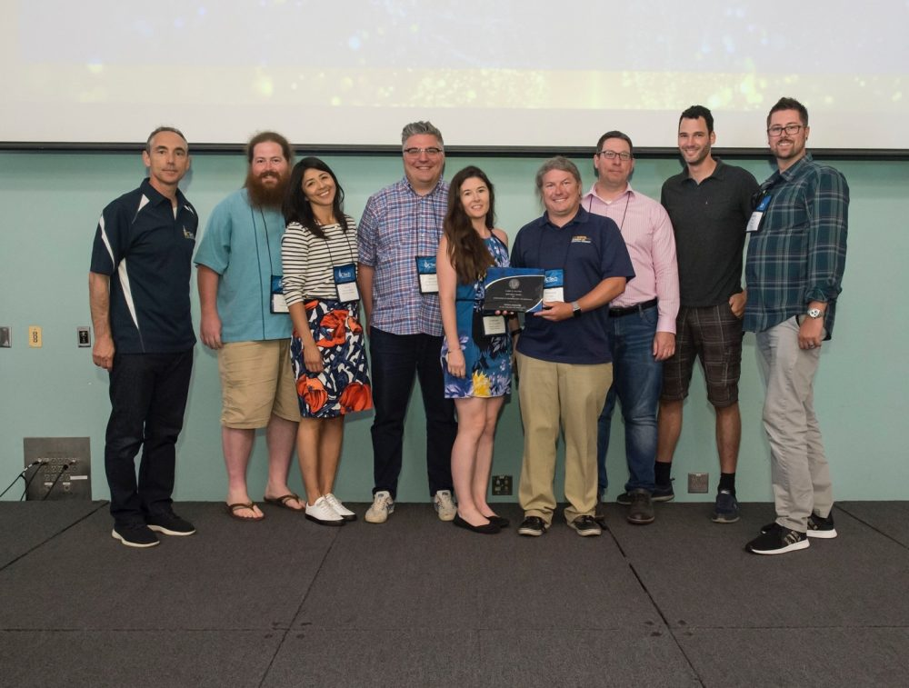 UC Tech 2019 Sautter Awards presentation. Mayra Solano, 3rd from left; Kristen Lineberger, 5th from left; and Shawn DeArmond (UCD), center, holding plaque.