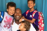 Van Williams, UC CIO, being hugged by his three children