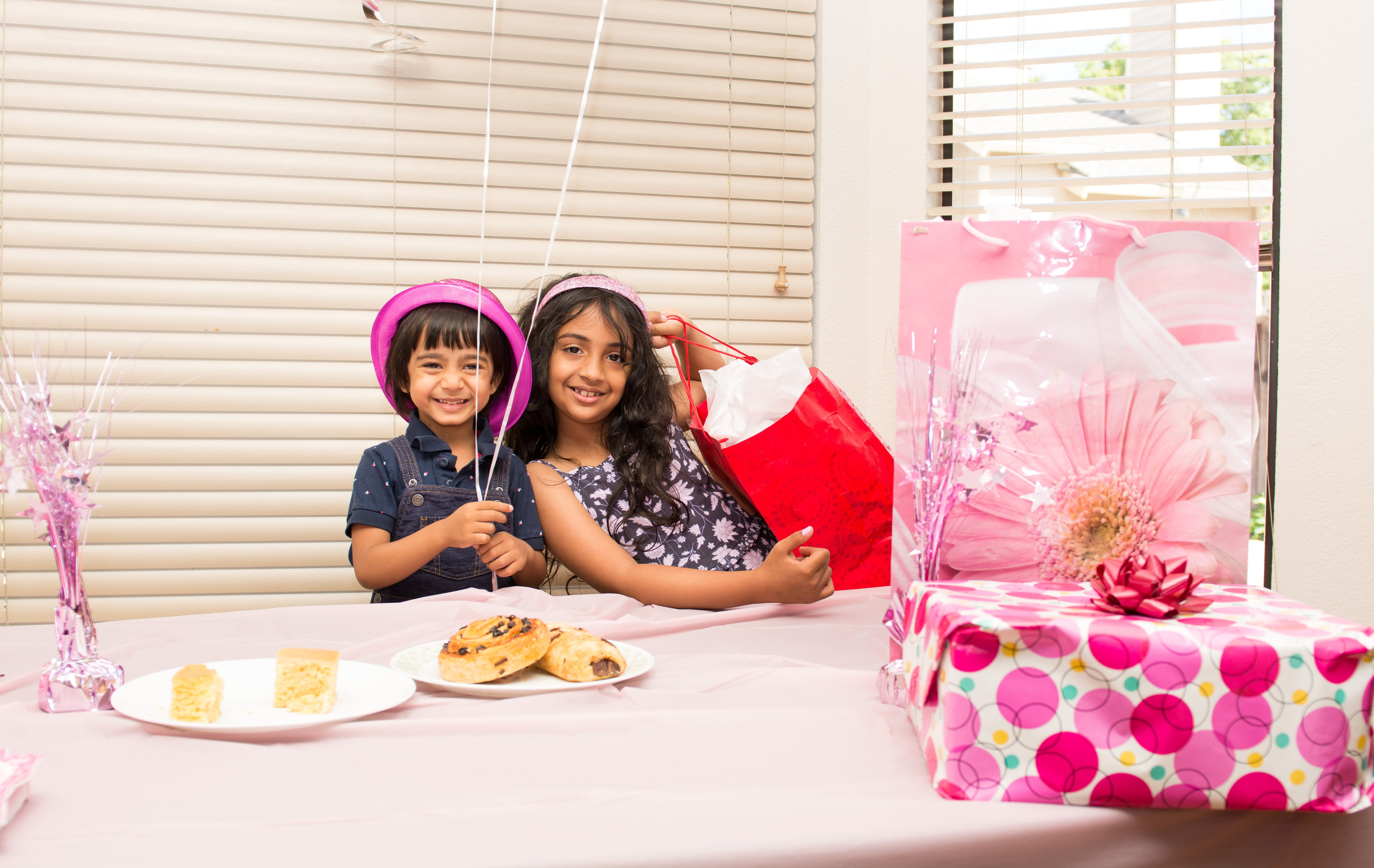 Two kids attend a birthday party